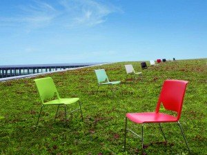 Plastic Chairs in a Field
